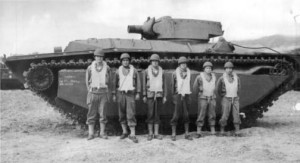 708th Amphibian Tank Bn. crew with their LVT(A)(4), equipped with the turret and 75mm howitzer of the M8 Howitzer Motor Carriage