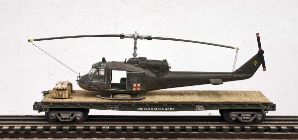 "US Army UH1C Huey Medevac Helicopter on 47′ Flat Car, Vietnam era USAX 23060(HELI1C-FC11.2USA)_Operates on 3-Rail ""O""Gauge track"