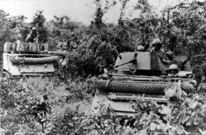 M113 Armored Personnel Carriers with cyclone fence RPG screens on front, Vietnam