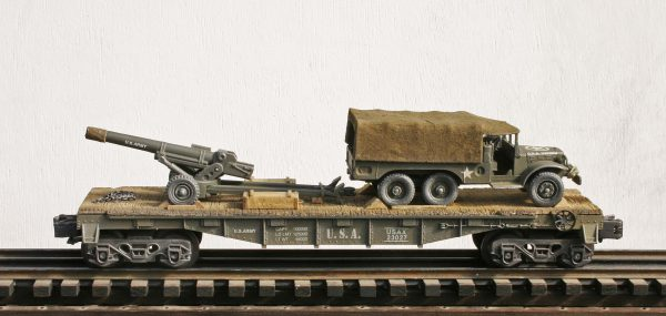 "US Army WC63 Dodge 1½ Ton Truck w/105MM Gun Tow on 40′ Flat Car USAX 23027(V14-FC2.2_USA)_Operates on 3-Rail ""O""Gauge track"