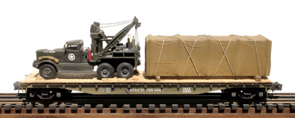"US Army Diamond T 969 Wrecker & Tarp Covered Cargo Load on 50′ flat Car USAX 23039(V15.2-FC6.2USA)_Operates on 3-Rail ""O""Gauge track"