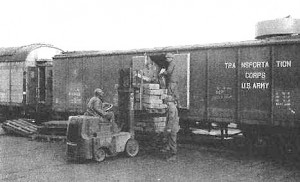 WWII Signal Corps Photo_US Army Transportation Corps Box Car being loaded.