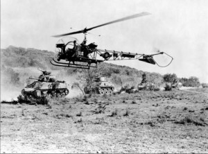 M4 Sherman medium tanks is observed by a Bell OH-13 Sioux helicopter, circa early 1950s.jpg