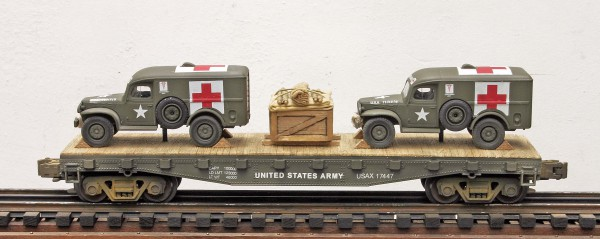 "US Army WC54 Dodge Ambulances(2) on 42′ Flat Car USAX 17447(MV3AA-FC3.2)_Operates on 3-Rail ""O""Gauge track"