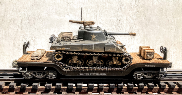 "U.S. Army M4A3(75) Sherman Tank on 35′ Drop Center Flat Car USA 23073(AV13.1-FC5.2USA)_Operates on 3-Rail ""O""Gauge track • Available Today •"