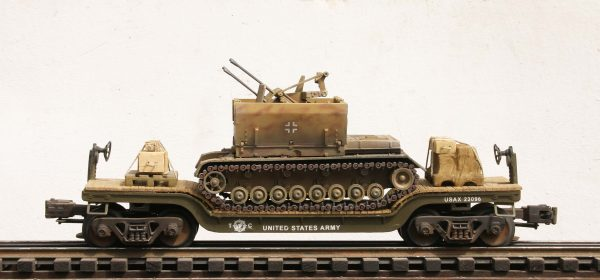 "US Army Captured WWII German 2cm FlakPz IV Tank on U.S. Army  Drop Center Flat Car USAX 23096(CAPAV14.1-FC5.2USA/GER)_Operates on 3-Rail ""O""Gauge track"