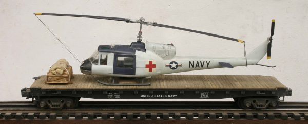 "US Navy UH1C Huey Medevac Helicopter on 50′ Flat Car, Vietnam era USNX 27523(HELI1C-FC6.2USN)_Operates on 3-Rail ""O""Gauge track"