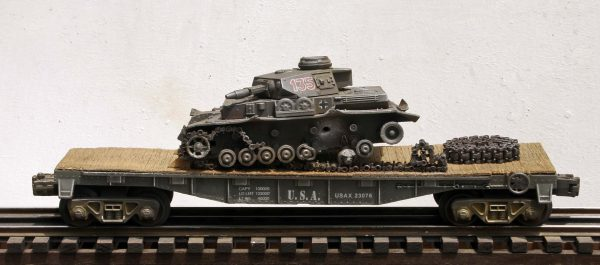 "US Army WWII Captured Battle Damaged German PzIVF1 Tank, Turret No.135 on U.S. Army 40′ Flat Car USAX 23076(CAPAV1D.2-FC2.2USA/GER)_Operates on 3-Rail ""O""Gauge track"