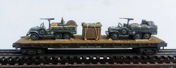 """US Army_WC63 DODGEx2 6×6 Open Top Cargo Carrier w-Supplies  & 50 Cal M.G.'s on Pedestal on 50′ Flat Car USAX 23003(MV9AA-FC6.2USA)_Operates on 3-Rail """"O""""Gauge track"""