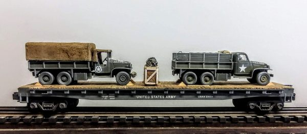 "US Army GMC 6X6 Trucks w/Cargo Cover & Gas Cans on 50′ Flat Car USAX 23024(MV1A.2D-FC6.2USA)_Operates on 3-Rail ""O""Gauge track"