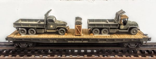 "US Army GMC 6X6 Cargo-Dump Trucks x 2 w/Cab Protectors on 50′ Flat Car USAX23001(MV1LM-LM-FC6.2USA)_Operates on 3-Rail ""O""Gauge track"