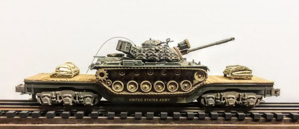 "US Army M48A3 Patton Tank, Vietnam, on 45′ Drop Center Flat Car USAX 23568(AV19-FC8.2USA)_Operates on 3-Rail ""O""Gauge track"
