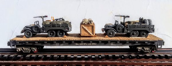 "US Army_WC63 DODGEx2 6×6 Open Top Cargo Carrier w-Supplies  & 50 Cal M.G.'s on Pedestal on 50′ Flat Car USAX 23547(MV9AA-FC6.2USA)_Operates on 3-Rail ""O""Gauge Track"