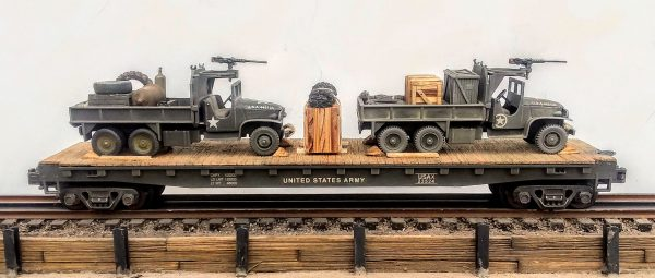 "US Army GMC 6X6 Dump Trucks x 2 with 50Cal. Machine Gun Rings & Cab Protectors on 50′ Flat Car USAX23524(MV1LGMK-FC6.2USA)_Operates on 3-Rail ""O""Gauge track"