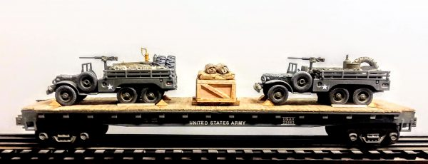 "US Army_WC63 Dodge x2 6×6 Open Top Cargo Carrier with Supply Loads  & 50 Cal M.G.'s on Pedestals on 50′ Flat Car USAX 23563(MV9AA-FC6.2USA)_Operates on 3-Rail ""O""Gauge Track"