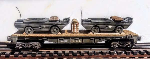 "US Army Amphibious GPA Jeeps on 40′ Flat Car U.S.A. 2362633(MV2AA-FC2.2USA)_Operates on 3-Rail ""O""Gauge track  • Available Today •"