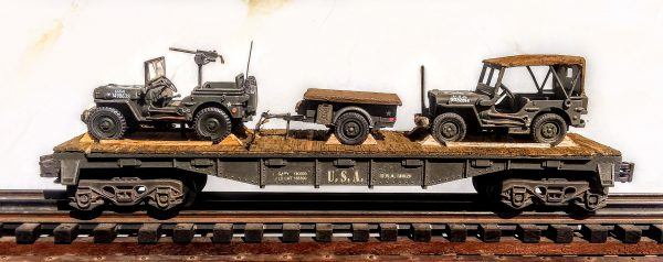 "US Army Willys Jeep w/30 Cal. M.G. & Willys Jeep w/Cover on 40′ Flat Car, U.S.A. 511269(MV4DA-FC2.2USA)_Operates on 3-Rail ""O""Gauge track"