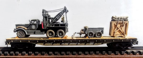 """US Army Diamond T 969 4-Ton Wrecker  w/1-Ton 4-Whl Trailer & Wood Crate Supply Load on 50′ flat Car USAX23039(V15.5-FC6.2USA)_Operates on 3-Rail """"O""""Gauge track  • Available Today •"""