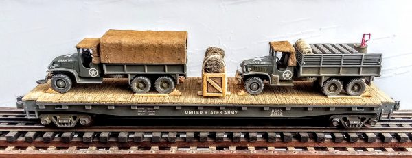 """US Army GMC 6X6 Cargo Truck w/Cover & Cargo Truck w/Gas Cans on 50′ Flat Car USAX 23532(MV1AD-FC6.2USA)_Operates on 3-Rail """"O""""Gauge track  • Available Today •"""