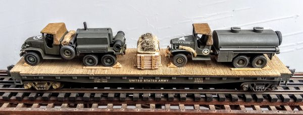 "US Army GMC 6X6 Leroi Compressor Truck & Water Container Truck on 50′ Flat Car USAX 23553(MV1EF-FC6.2USA)_Operates on 3-Rail ""O""Gauge track"