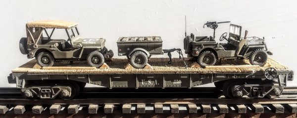 """US Army Willys Jeep w/30 Cal. Machine Gun & Willys Jeep w/Cover & Tow Trailer w/Gas Cans on 40′ Flat Car, U.S.A. U.S.A.223097(MV4DA-FC2.2USA)_Operates on 3-Rail """"O""""Gauge track  • Available Today •"""