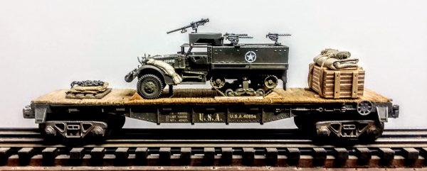 """US Army M3A1 Half Track w/50 Cal Gun Ring & Supply Load on 40′ Flat Car U.S.A. 40854(AV9F.4-FC2.2USA)_Operates on 3-Rail """"O""""Gauge track"""