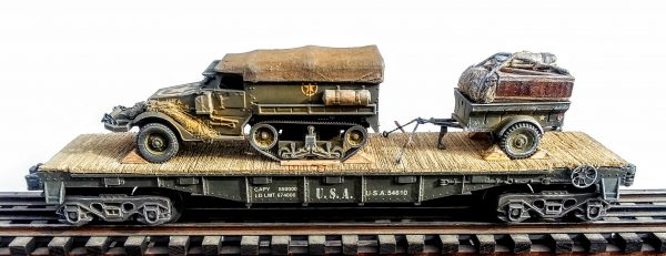 "US Army M3 Half Track Troop Carrier w/Cover & Trailer Tow w/Supply Load on 40′ Flat Car U.S.A. 54610(AV9A.1-FC2.2USA)_Operates on 3-Rail ""O""Gauge track"