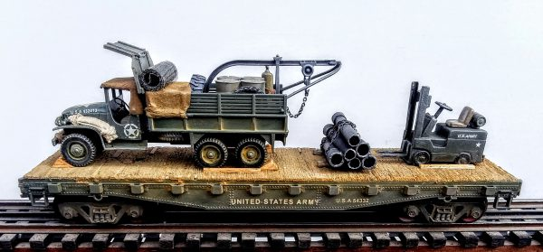 "US Army GMC Cargo Truck w/Rescue Hoist & Fork Lift Truck on 42′ Flat Car w/Stacked Pipe Load, U.S.A. 54332(V8C.2-FC3.2USA)_Operates on 3-Rail ""O""Gauge track"