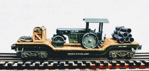 """U.S. Army Engineers Road Roller & Pipe Load on Drop Center Flat Car USA 511629(EME34-FC2.2USA)_Operates on 3-Rail """"O""""Gauge track • Available Today •"""